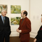 Ceri Thomas showing Rhodri Morgan, AM, and Jane Hutt, AM, the 'Joan Baker: a retrospective' exhibition, 2009
