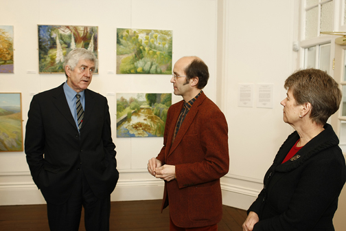 Ceri Thomas showing Rhodri Morgan, AM, and Jane Hutt, AM, around the 'Joan Baker: a retrospective' exhibition, Oriel y Bont 2009