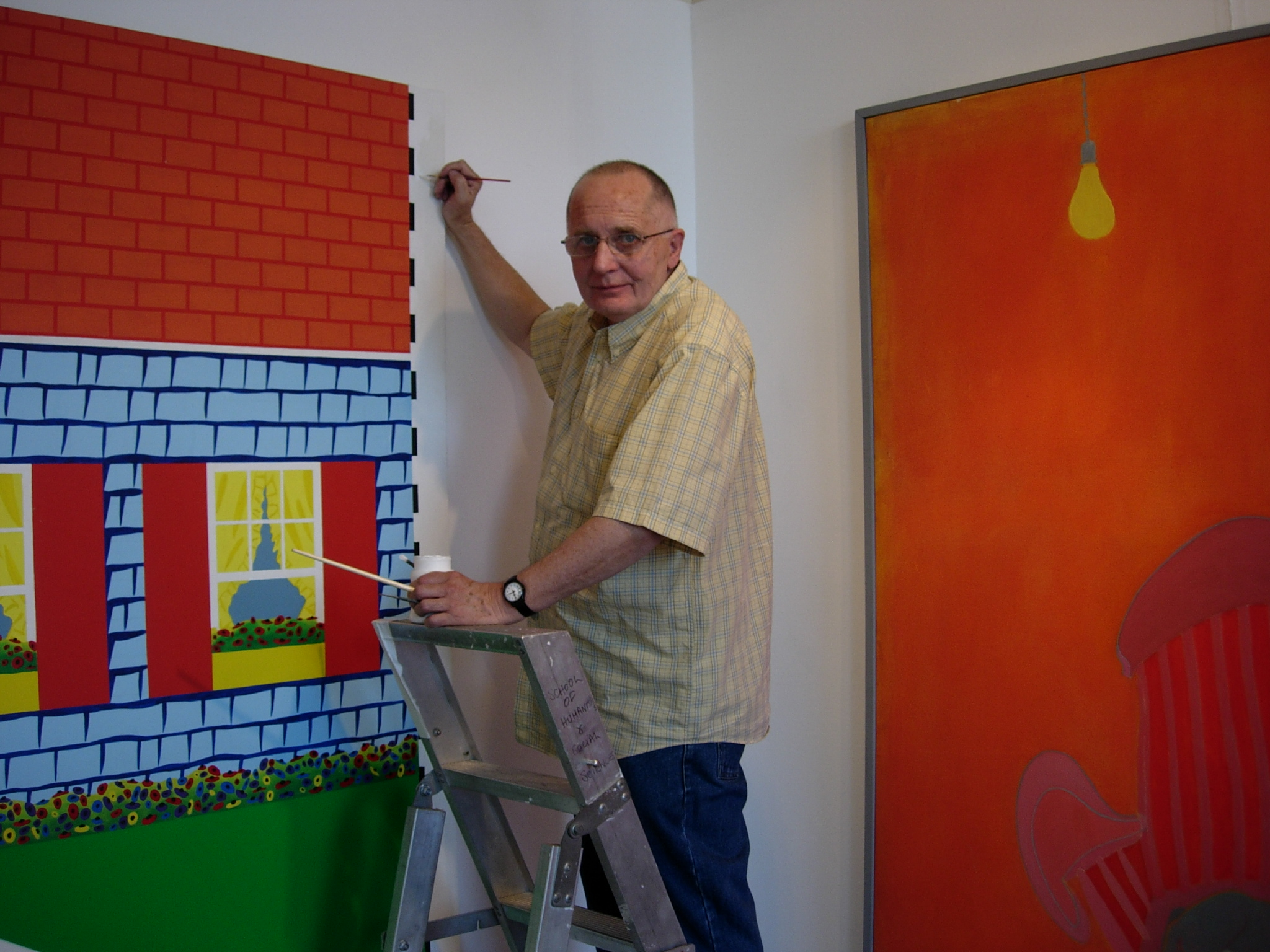 Ken Elias retouching his painting 'Days are where we live' hung alongside an Ernest Zobole painting, Zobole Gallery 2006