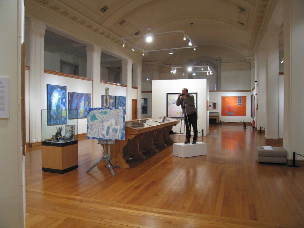 Ceri Thomas photographing the 'Ernest Zobole: a retrospective' exhibition, National Library of Wales 29 December 2004