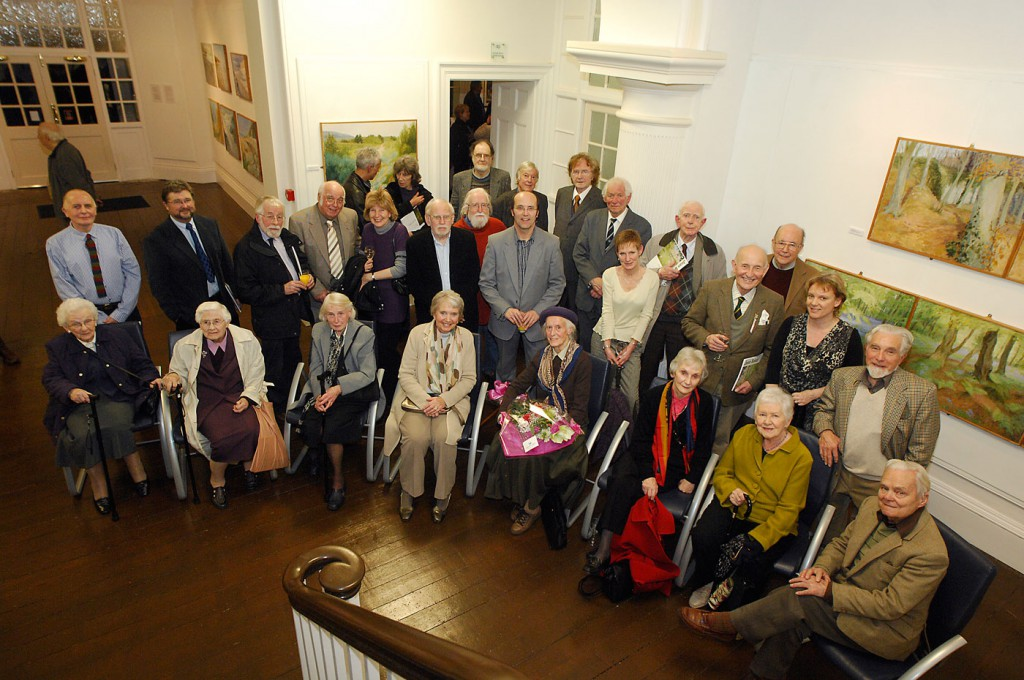 Joan Baker (seated with flowers) and Ceri Thomas (standing) with some of her former pupils and staff colleagues, Oriel y Bont 9 December 2009