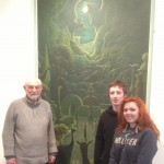 Ron Lawrence with his painting 'Adam and Eve' and two University of South Wales art students, Oriel y Bont, 2013