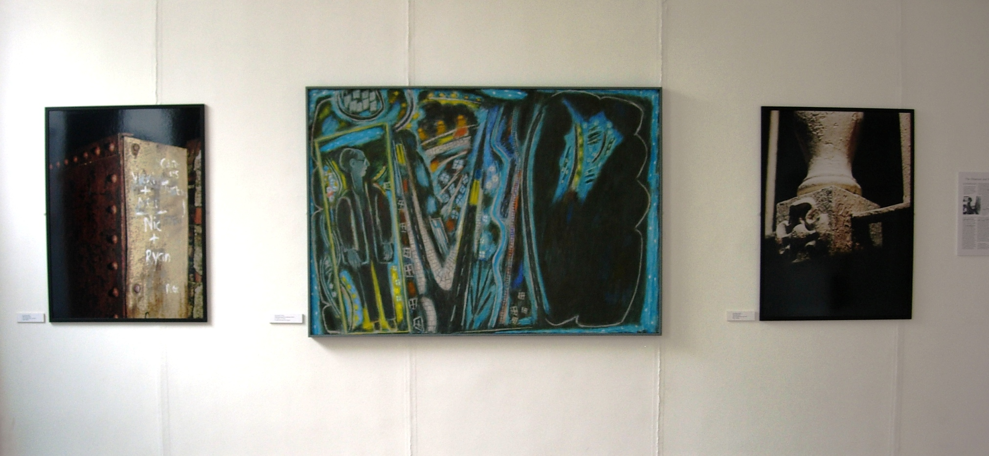 A late painting by Ernest Zobole flanked by photographs by Paul Cabuts, 2006